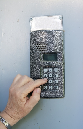 Close-up of uses intercom in steel door photo