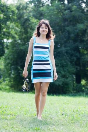 barefoot women: beautiful barefoot woman walking on lawn
