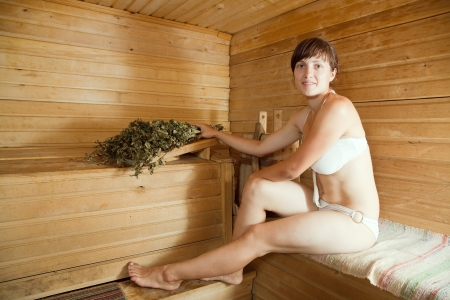 bathhouse: Young woman is taking a steam-bath  at sauna  Stock Photo