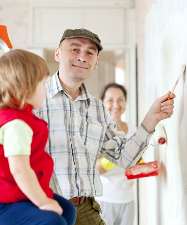 priming brush: Happy family makes makes repairs in apartment together