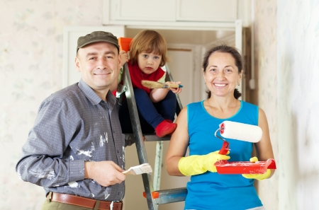 priming brush: Parents with child repairs at new home Stock Photo