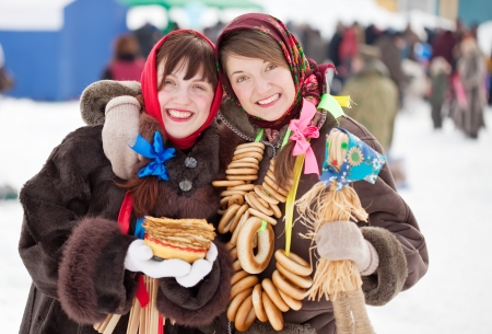 sudarium: Two happy girls plays during Shrovetide at Russia