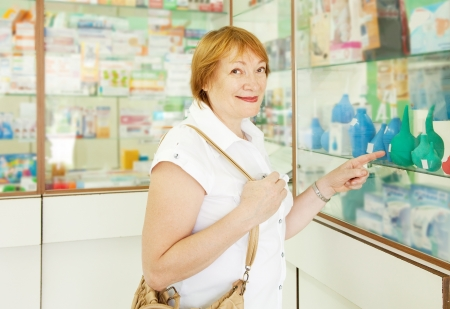 Mature woman chooses enema at the pharmacy photo