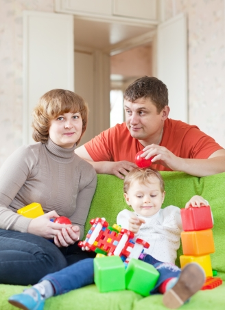 Portrait of family of three in home Stock Photo - 16274443