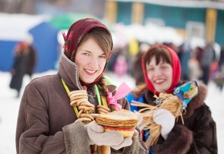 sudarium: Smiling girls in russian traditional clothes with pancake during  Shrovetide Stock Photo