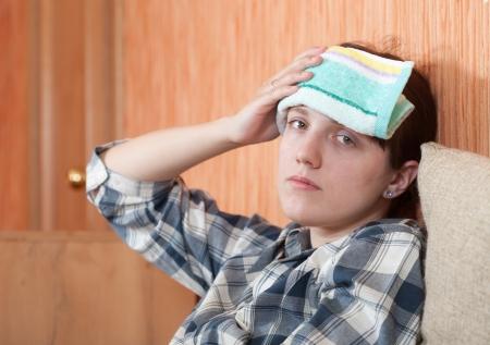 woman having  headache holding towel on her head Stock Photo - 16330908