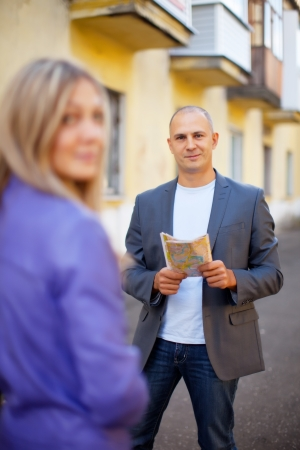 Male tourist asks for directions from a woman Stock Photo - 16331154