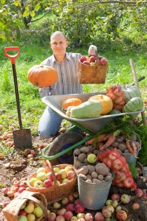 Happy man with vegetables harvest in september garden Stock Photo - 16326327