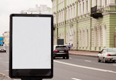 Blank billboard at city road photo