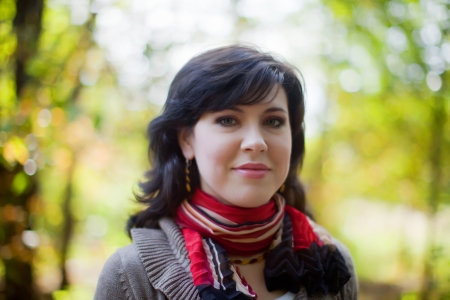 happy seasonable: Portrait of brunette woman in autumn park  Stock Photo