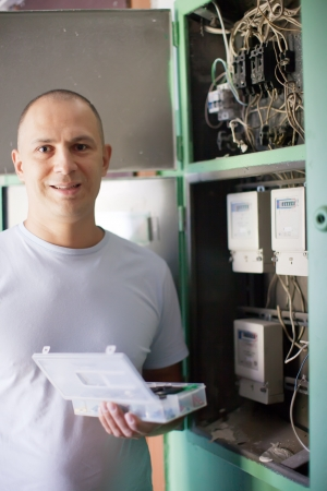 Man working with electric box at house Stock Photo - 16374676