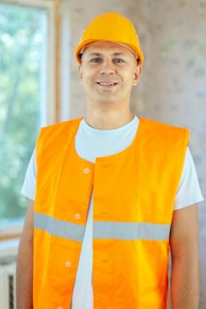 Portrait of builder at construction site