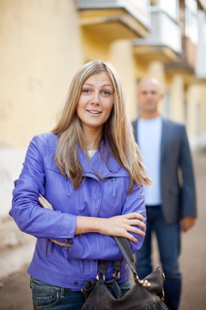 molestation: A man walks behind woman on the street