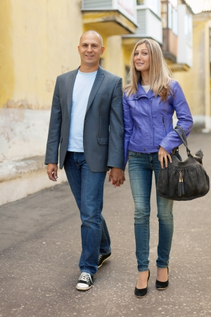 beautiful woman with man walking the street together photo