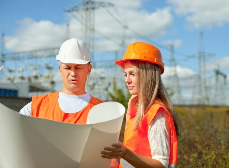 two workers wearing protective helmet works at electrical power station. Stock Photo - 16374556