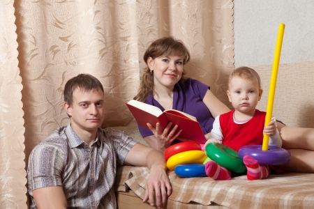 Family  relaxing with book at home  photo