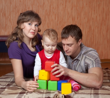 Happy parents with toddler in home interior Stock Photo - 16410502