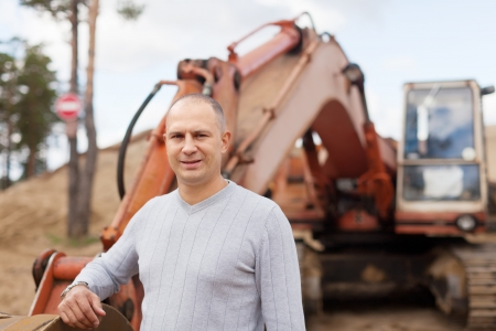 Portrait of tractor operator at sand pit photo