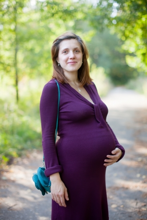 Portrait of pregnant woman walks september park Stock Photo - 16486780
