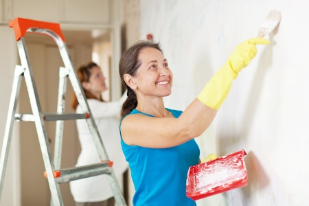 Happy women  making repairs at room Stock Photo - 16486785