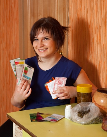 seeds of various: Young woman with various seeds  at home