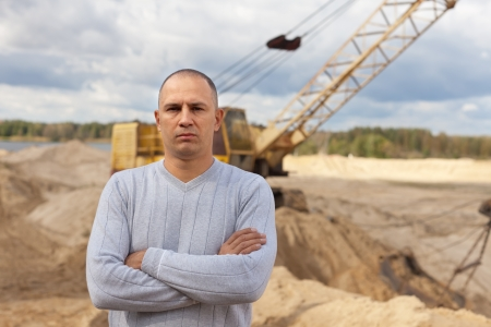Portrait of worker  at sand pit photo