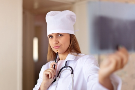 auscultoscope: Doctor  looking an x-ray image in clinic