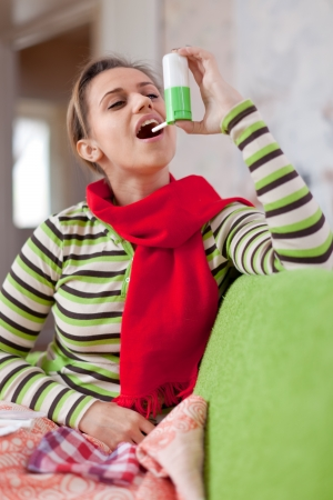 Young illness woman uses spray in home Stock Photo - 16516216