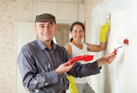 Happy man and woman paints wall at the apartment  together Stock Photo - 16545550