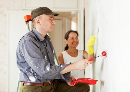 woman and man making repairs at living room Stock Photo - 16545555