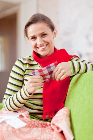 rheum: sick woman uses handkerchief in home Stock Photo