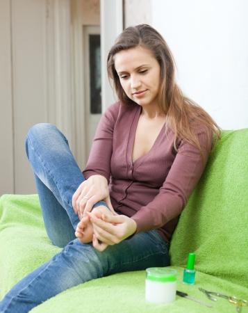 beauty woman treats her toenails Stock Photo - 16563695
