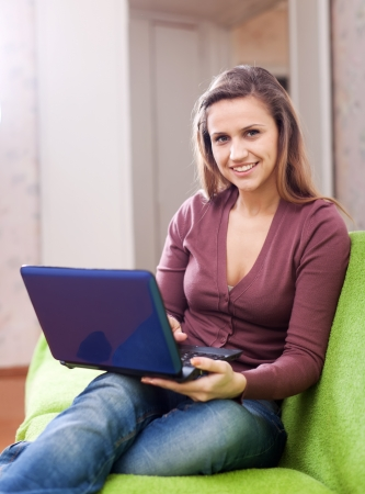 Young woman using netbook in home Stock Photo - 16563435