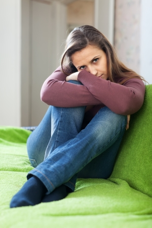 sadness beautiful woman sits on sofa at  home Stock Photo - 16563706