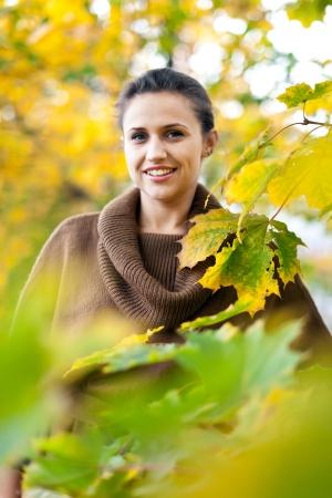 Portrait of beauty woman in autumn park  photo