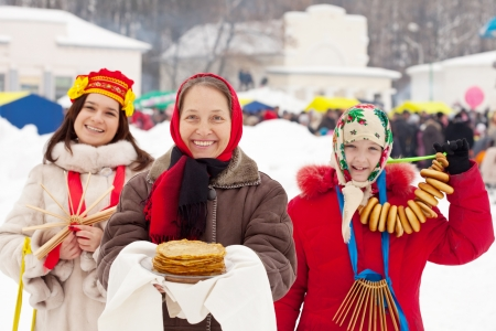 sudarium: Mature woman with pancakes during  Shrovetide at Russia Stock Photo