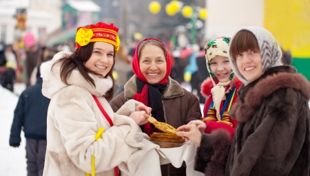sudarium: People eating pancakes during  Maslenitsa festival in Russia Stock Photo