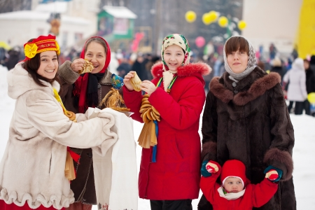 pancake week:  happy people celebrating  Pancake Week at Russia