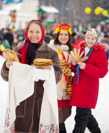 mature woman with pancake during   Maslenitsa festival at Russia photo
