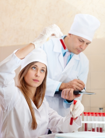 nurse and male doctor works with test tubes in clinic lab  Stock Photo - 16709626