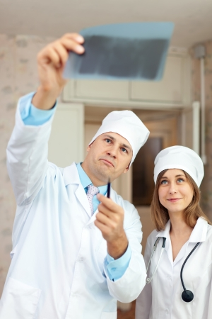 friendly doctors looking x-ray scan  in clinic Stock Photo - 16709705