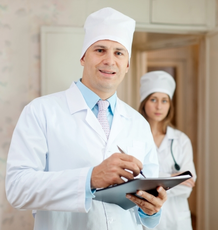 auscultoscope: Portrait of two doctors in clinic interior