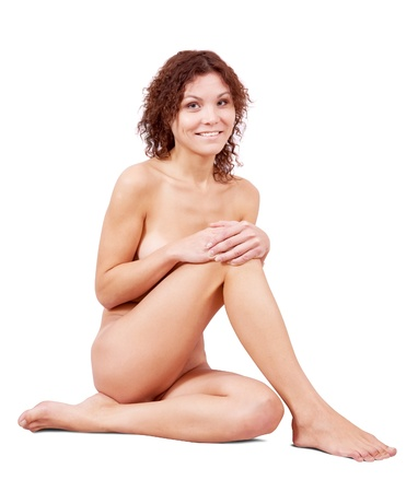 Sitting nude girl over white background photo