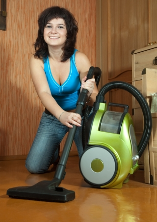 girl cleans with vacuum cleaner at home Stock Photo - 16753238