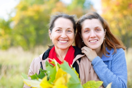portrait of two happy women in autumn  garden Stock Photo - 16753317