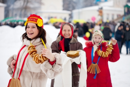 Women  with pancakes during  Maslenitsa festival in Russia photo