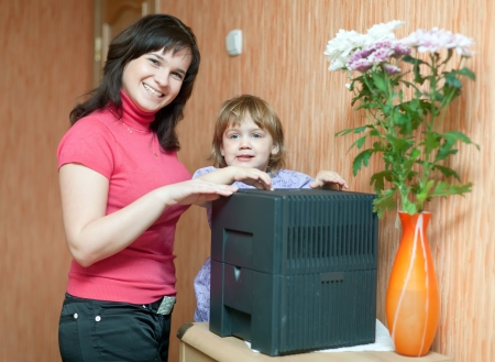 Woman and child uses humidifier at home  Stock Photo - 16753215