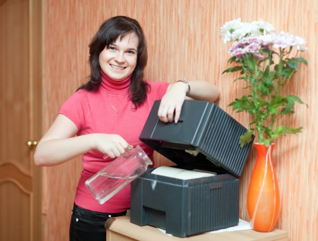 ionizer:  Woman uses humidifier at home