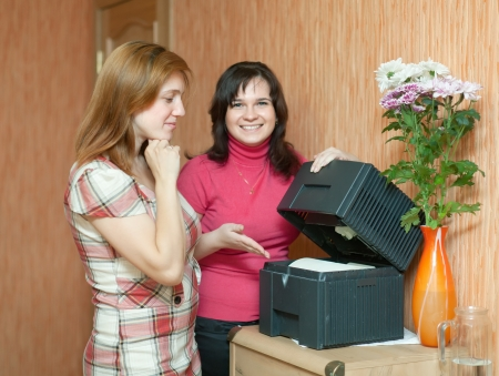 Two women uses humidifier  at home   photo