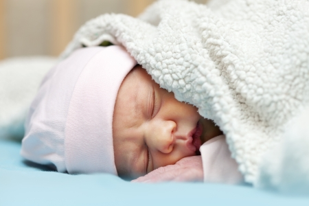 newborn baby sleeps under blanket Stock Photo - 16764257